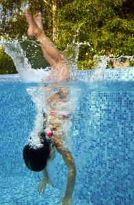 14747132-active-underwater-child-jumps-to-swimming-pool-little-girl-swims-and-having-fun-kids-sport-on-family