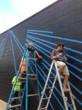 Taping the mural